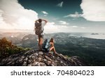 hikers relax on top of a... | Shutterstock . vector #704804023