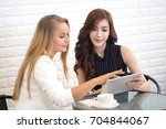 woman using tablet for work at... | Shutterstock . vector #704844067