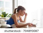 stressed millennial woman lying ... | Shutterstock . vector #704893087