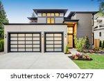 luxurious new construction home ... | Shutterstock . vector #704907277