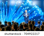 audience listens to the... | Shutterstock . vector #704922217