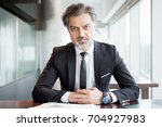 business man sitting at desk... | Shutterstock . vector #704927983