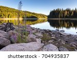 mountain lake with pine forest... | Shutterstock . vector #704935837