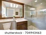modern bathroom features a dark ... | Shutterstock . vector #704943463