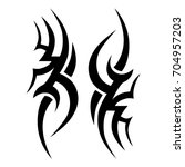 tribal tattoo art designs.... | Shutterstock .eps vector #704957203