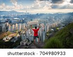 traveler hands up on the hill... | Shutterstock . vector #704980933