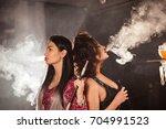 girls standing back to back in... | Shutterstock . vector #704991523