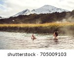 girl in a hot spring in iceland ... | Shutterstock . vector #705009103