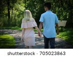 a couple is walking in the park ... | Shutterstock . vector #705023863