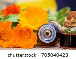 marigold extract in a small... | Shutterstock . vector #705040423
