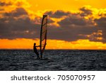 girl riding windsurf on the... | Shutterstock . vector #705070957