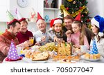 large family enjoying festive... | Shutterstock . vector #705077047
