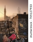 Small photo of MAKKAH, SAUDI ARABIA 30 Nov 2016 : Makkah iconic Zam Zam Tower seen from Ajyad Valley. One of the slum area near Masjidilharam.