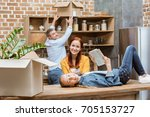 smiling teenage girl with book... | Shutterstock . vector #705153727