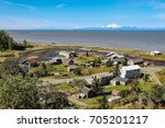 Small photo of Aerial view of Ninilchik a small Alaskan Native village with Cook Inlet and Aleutian volcanoes , Alaska