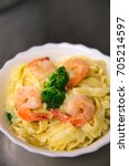 Small photo of Creamy Fettuccine Alfredo with shrimps and broccoli
