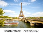 view on the famous eiffel tower ... | Shutterstock . vector #705220357