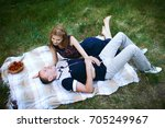 happy man and woman on plaid | Shutterstock . vector #705249967