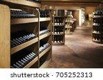 champagne bottles in wine store | Shutterstock . vector #705252313