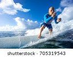 muscular surfer riding on big... | Shutterstock . vector #705319543
