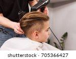 little boy getting haircut by... | Shutterstock . vector #705366427