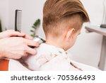 little boy getting haircut by... | Shutterstock . vector #705366493