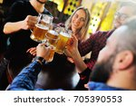 a company of friends drink beer ... | Shutterstock . vector #705390553