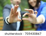 ring and hand | Shutterstock . vector #705430867