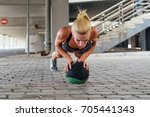 young female athlete doing push ... | Shutterstock . vector #705441343