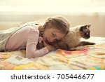 cute girl with pigtails plays... | Shutterstock . vector #705446677