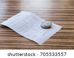 the coins are placed on the... | Shutterstock . vector #705533557