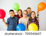 happy children with balloons | Shutterstock . vector #705540607