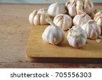 garlic on wooden board | Shutterstock . vector #705556303