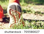 close up of running shoes on... | Shutterstock . vector #705580027