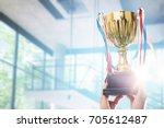 businessman holding award... | Shutterstock . vector #705612487