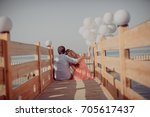 love story on the bridge at the ... | Shutterstock . vector #705617437