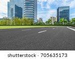 empty asphalt road front of... | Shutterstock . vector #705635173