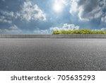empty asphalt road in the blue... | Shutterstock . vector #705635293