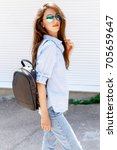 young stylish woman wearing... | Shutterstock . vector #705659647