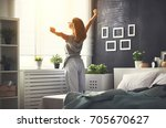 young happy woman woke up in... | Shutterstock . vector #705670627