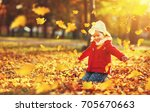 Happy Child Girl Throws Autumn...