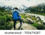 man traveling in mountain... | Shutterstock . vector #705674287