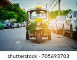 tuk  tuk parked on the street... | Shutterstock . vector #705693703