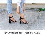 women's legs in blue cropped... | Shutterstock . vector #705697183