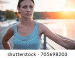 sad woman standing by the water ... | Shutterstock . vector #705698203