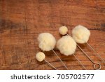 Small photo of wool dauber to apply dye stain and finish to leather crafts, on wooden background