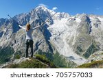 happy hiker at mountain top.... | Shutterstock . vector #705757033