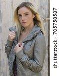 a blonde model posing in an... | Shutterstock . vector #705758587