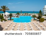 territory of the hotel with a... | Shutterstock . vector #705800857