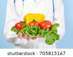 young nutritionist with fresh... | Shutterstock . vector #705815167